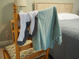 clothes drying on a bedroom chair