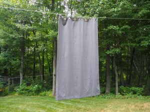 blackout curtains hanging on a clothes line
