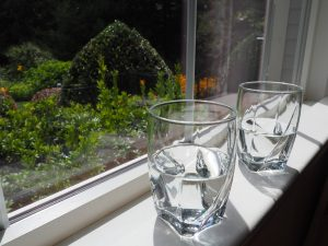 water evaporating from glasses next to window