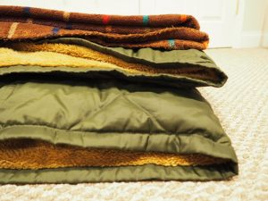 blankets in a pile