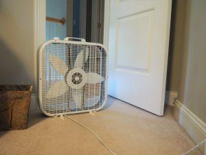 box fan in the bedroom doorway