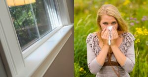 closed window and woman sneezing due to pollen
