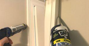caulk being applied to a door
