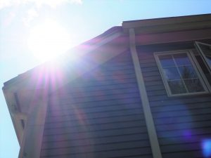 sunlight coming over the top of a house