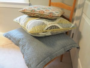 pillows stacked on a chair